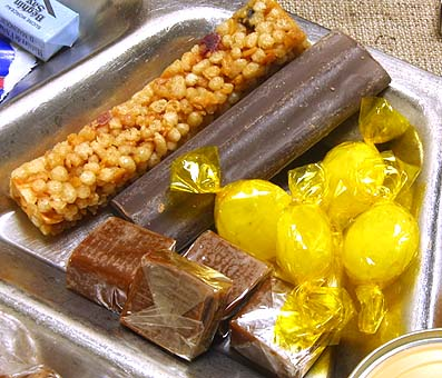 French RCIR cereal bar, chocolate energy bar, lemon-flavored hard candy, and caramels