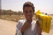 Child with Humanitarian Daily Ration