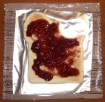 Grape jelly on wheat snack bread